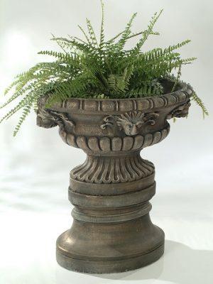 Pot à fleurs avec quatre lions